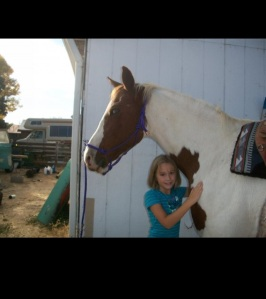 Me and my first horse, Bella when I was 7....